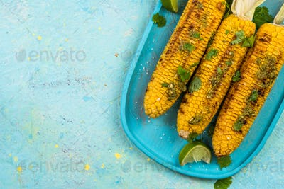 Serving grilled corn cob on vibrant pastel board