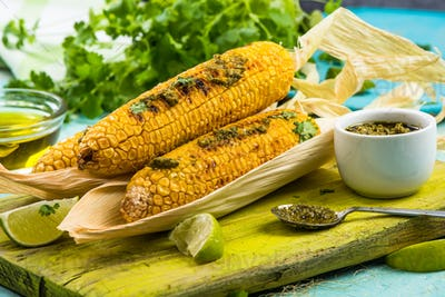 Whole corn cob grilled in husk