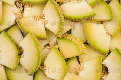 Honeydew melon slices, full frame food background