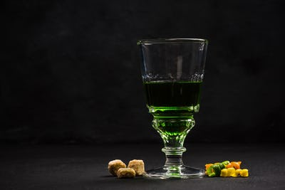 Green Absinthe in crystal glass
