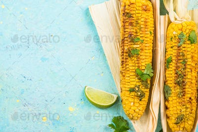 Grilled corn in husk with lime, copy space
