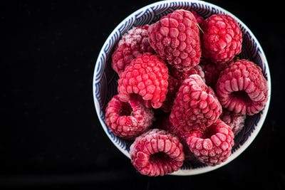 Frozen raspberry fruits, copy space