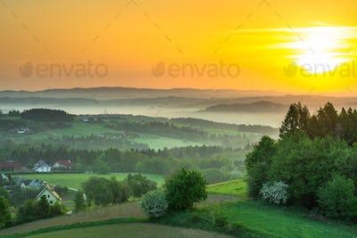 Spring fog over countryside at sunrise
