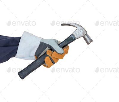 Hand in glove holding hammer on white