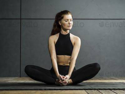 Beautiful woman stretching her legs