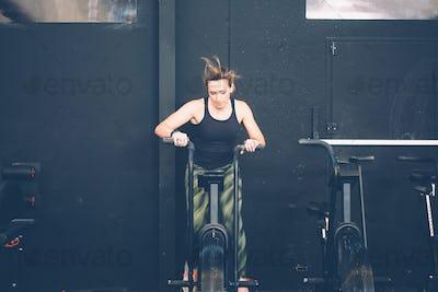 Girl doing calorie assault exercise