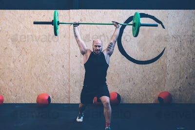 Man doing jerks with barbell