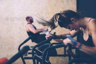 Young woman does calorie assault exercise