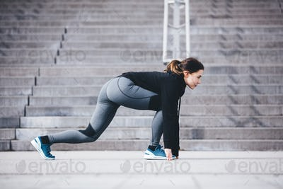 Sportswoman in a starting position, ready to run