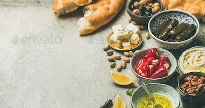Mediterranean or Middle Eastern meze starter fingerfood assortment, wide composition