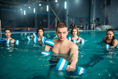 Trainer and female aqua aerobics group, swimming
