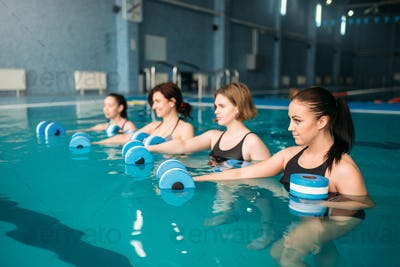 Group doing exercise with dumbbells, aqua aerobics