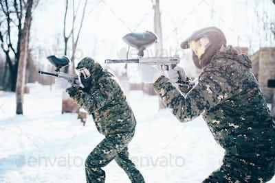 Paintball team in uniform attack in winter battle