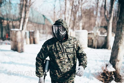 Male paintball player, military game equipment