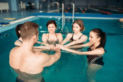 Trainer and female group, aqua aerobics training