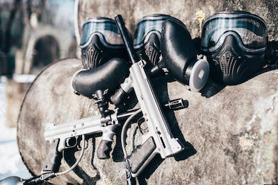 Paintball masks with glasses and marker guns
