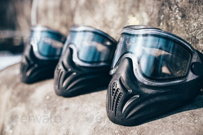 Paintball masks with glasses closeup, nobody
