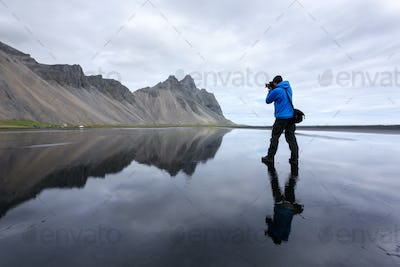 Photographer take photo near famous Stokksnes mountains