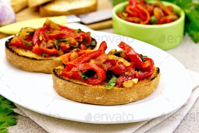 Bruschetta with vegetables in plate on granite table
