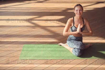 Smiling woman doing yoga