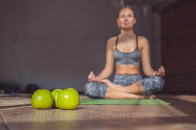 Young girl in a lotus in yoga class