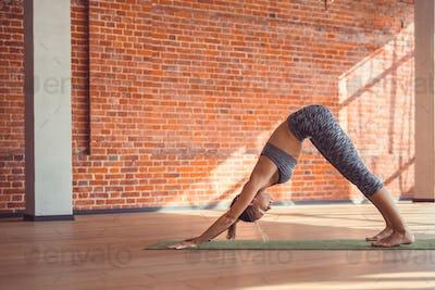 Young woman practicing gymnastics