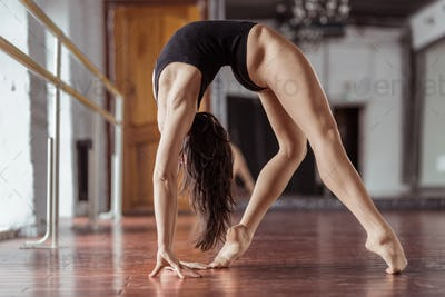 Active young woman in dance studio