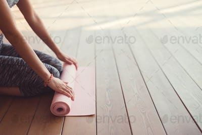 Young girl with a mat close-up