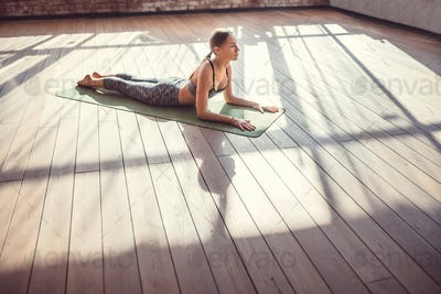 Young girl practicing yoga in the sunlight