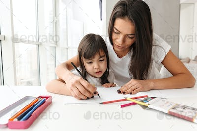 Image of beautiful people woman and child sitting at table in fl