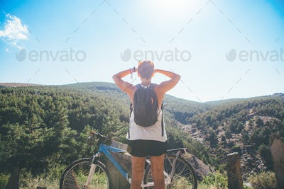 Sporty woman admires the view