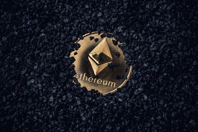 Gold coin with cryptocurrency logo