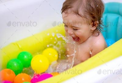 Happy boy bathing