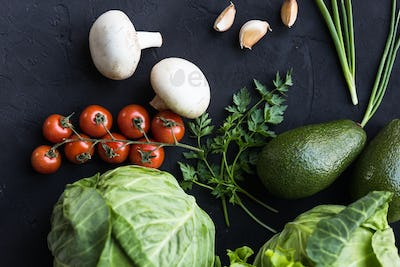 Fresh vegetables: cabbage, avocado, tomato, rosemary, garlic, mushrooms, leeks