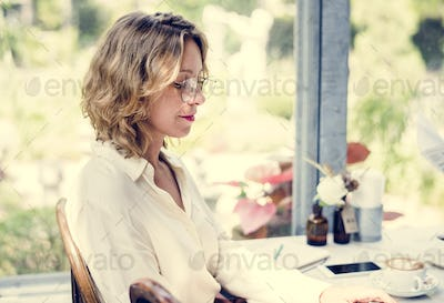 Woman in a cafe drinking coffee