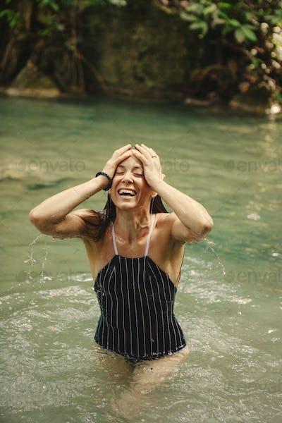 Beautiful woman at a waterfall