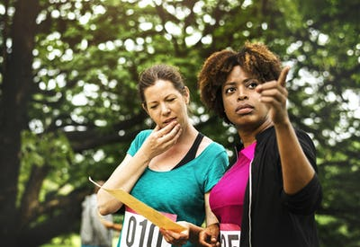 Women looking at the map for orienteering box location