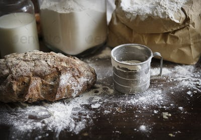 Flour and bread on a messy kitchen top