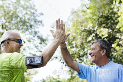 Senior adults giving a high five