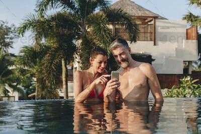 Honeymoon couple happy time in swimming pool