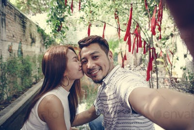 Happy couple taking selfie together