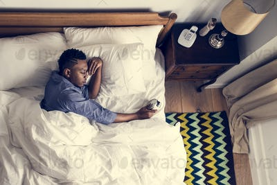 Man waking up in the morning by an alarm clock