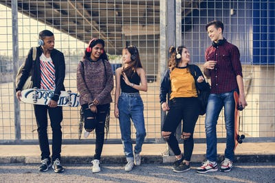 Group of school friends outdoors lifestyle and leisure music concept