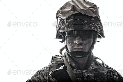 Equipped army soldier with dirty face studio shot