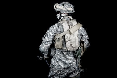 Army soldier equipped for mission in desert area