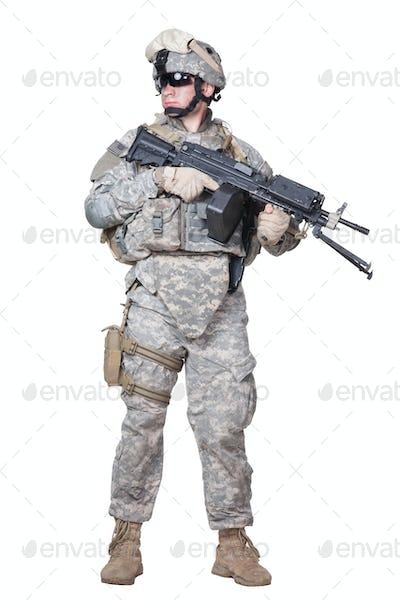 Full equipped US marine standing with machine gun