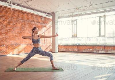 Sport girl practicing yoga