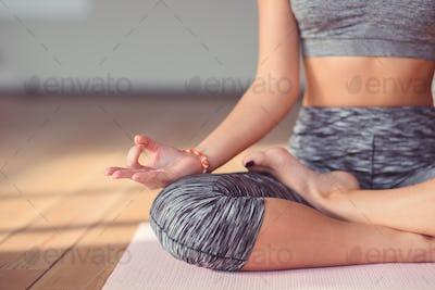 Young woman meditating close-up