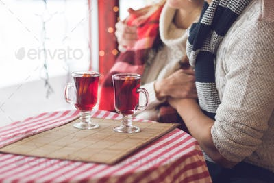 Young couple with glasses of mulled wine