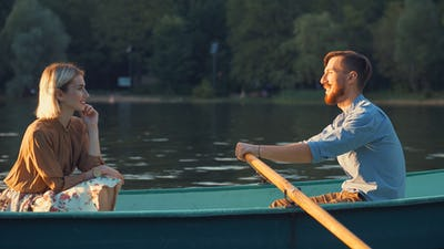 Attractive couple in a boat